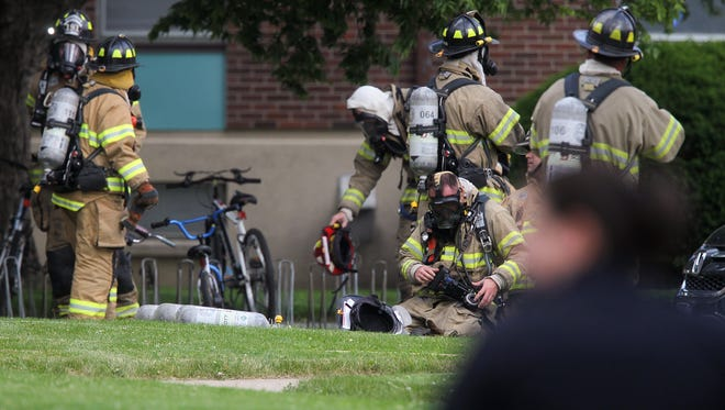 Local emergency responders gather at the scene of a reported explosion at the apartments on Hawkeye Drive on Friday, May 27, 2016.