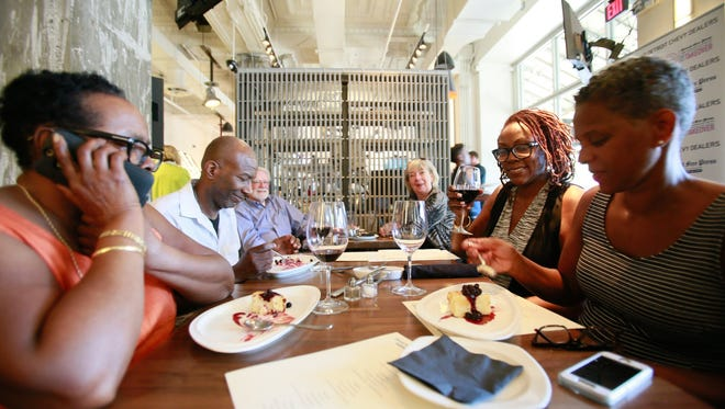Zana Smith, Steven Miller, Meagan Mitchell and Phyllis Hurks-Hill dine during the Top 10 Takeover at Central Kitchen + Bar in downtown Detroit on Tuesday, May 31, 2016.