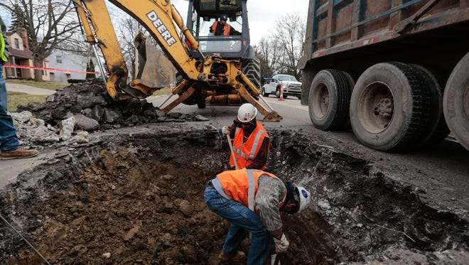 Crews work on finding the water main to replace the lead service line from the main to the valve box with a copper line for two houses on Welch Blvd. in Flint on Monday March 21, 2016.