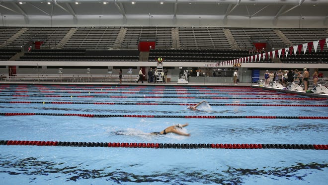 Swimmers practice in the newly renovated IUIPUI Natatorium on June 7, 2016 in Downtown Indianapolis.