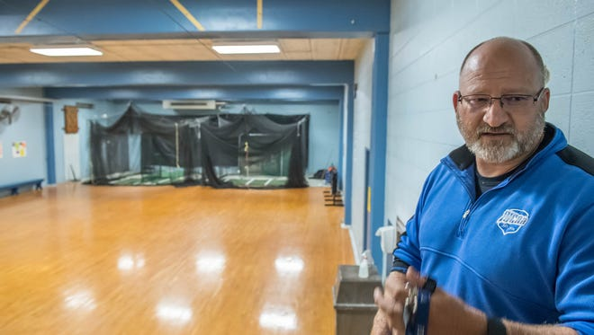 Kellogg Community College Athletics and Physical Education Director Tom Shaw shows the auxiliary gym at the Miller Physical Education Building, a room that houses both batting cages and classes like yoga and pilates. The college has plans to demolish the building and build a new center for athletics and recreation.