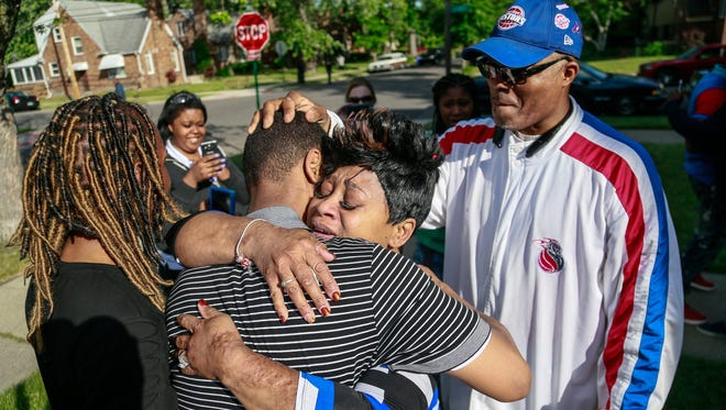 Taminko Sanford-Tilmon embraces her son, Davontae Sanford after he was released from prison after serving close to nine years in prison for a quadruple homicide officials now believe he did not commit, in Detroit on Wednesday, June 8, 2016. Apostle W.J. Rideout III looks on.
