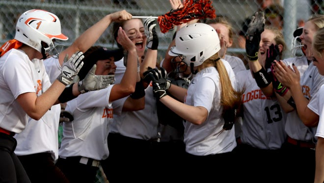 Scio players surround home plate and celebrate Kelsey Pollard's home run in the Rainier vs. Scio softball game, in the semifinals of the OSAA Class 3A state playoffs, at Scio High School on May 31. Rainier won the game 6-4.