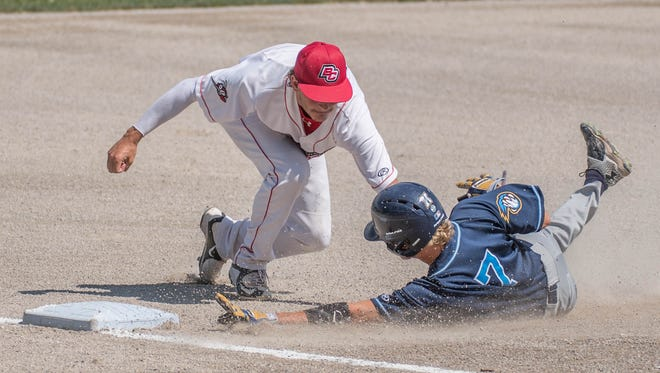Battle Creek Bombers Jarrod Watkins tags the runner at third in the home game of Monday's double header against the Kalamazoo Growlers.