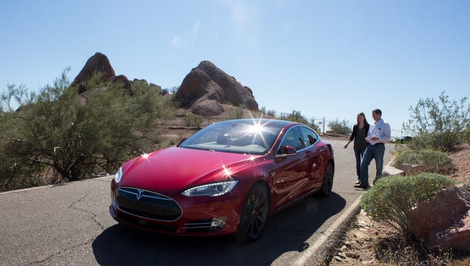 Tesla Motors, which makes the Model S P90D shown here at Papago Park, has offered to buy SolarCity.