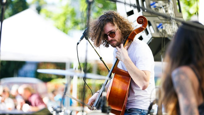 Matt Cartmill plays the cello as Human Ottoman performs at the Archway Alley Stage at Make Music Day on Tuesday, June 21, 2016.