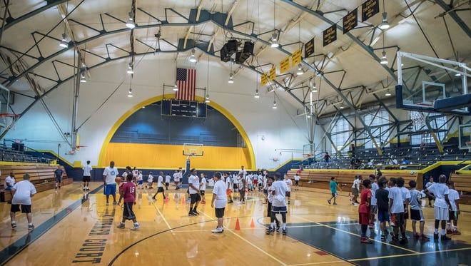 Kids improve their basketball skills during a clinic at the Battle Creek Central Fieldhouse earlier this summer.