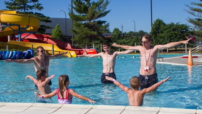 Full Blast lifeguards Zack Phelps, Trevor Young and Ben Smith begin instructing the Mileski family on the basics of swimming during a 30-minute lesson.
