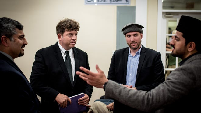 Matthew Jansen, second from left, is greeted by Mubashir Mumtaz, left, Christopher Khalid-Janney and Hassan Ahmed before attending prayer and dinner at the Hadee Mosque of the Ahmadiyya Muslim Community in Harrisburg on Friday, June 24, 2016. Jansen, a Spring Grove Area School Board Member and Republican delegate from York County attracted attention after disparaging comments made against Muslims and Islam.