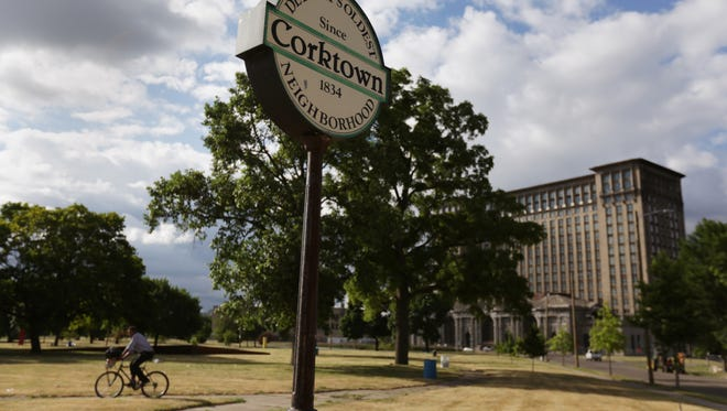 Roosevelt Park and Michigan Central Station in Corktown in Detroit on Tuesday, June 28, 2016.