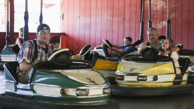 People ride on the bumper cars at the Indiana Beach Boardwalk Resort on Friday, June 17, 2016 in Monticello, IN.