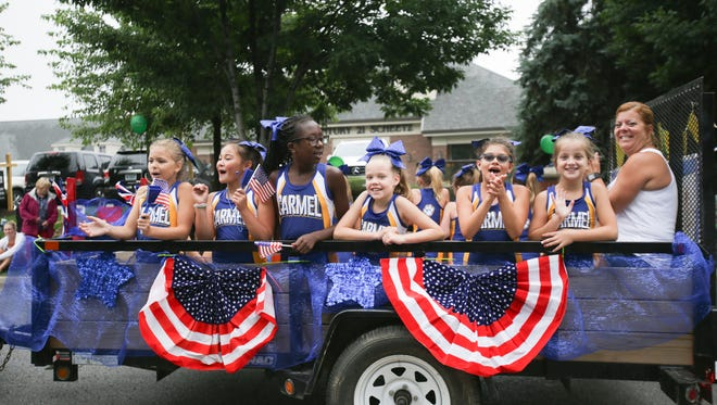 The pups cheerleaders during the patriotic 4th of July Parade at CarmelFest on Monday, July 4, 2016.