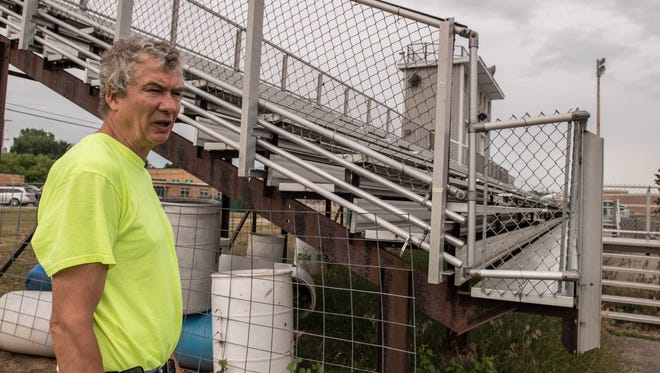 Pennfield Building and Grounds Director Ken Shedd stands by the home side bleachers at Pennfield High School's football fields. New bleachers is one of several improvements that would be funded if voters approve an $8.25 million bond proposal Aug. 2.