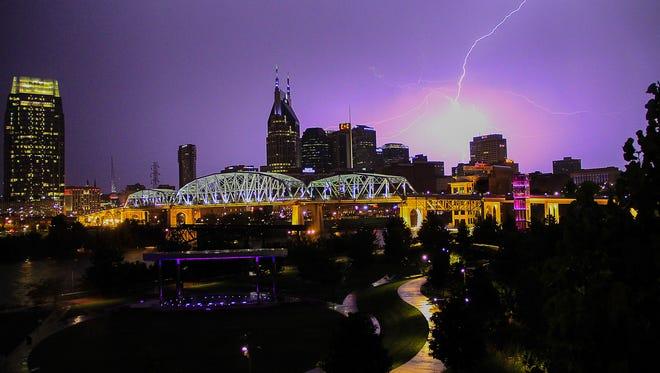 Lightning strikes across the Nashville skyline Friday night during a round of severe thunderstorms.
