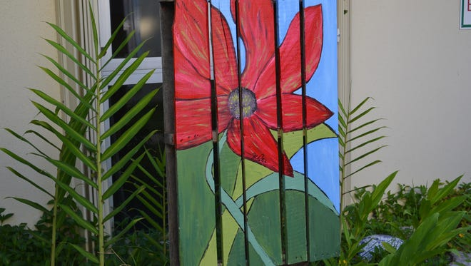 Wood pallet becomes yard art in The Whimsy Garden.
