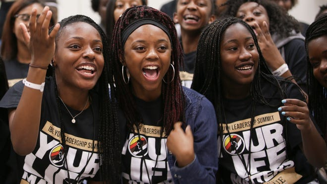 Jasmin Cheairs, Dareyona Washington, and Lisa Pearshall react after seeing Flex Alexander on the court during the Amp Harris & Reggie Wayne Celebrity basketball game at the Indiana Convention Center on July 16, 2016. The event was part of the 46th Indiana Black Expo Annual Summer Celebration.