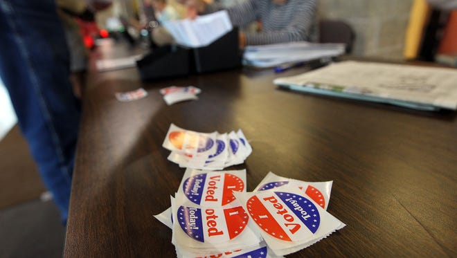 Voter stickers are distributed at West High on Tuesday, July 19, 2016, during the Iowa City Community School District special school board election.