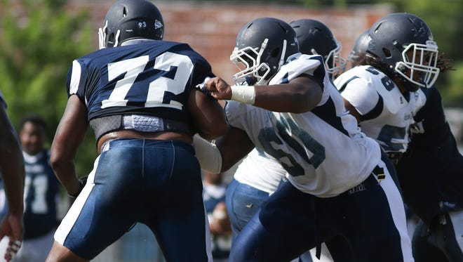 Markus Cook, pictured in white, shifted between center and guard this spring for JSU.