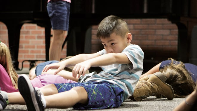 Children participate in an exercise during Improv class at the Center for Performing Arts summer camps.