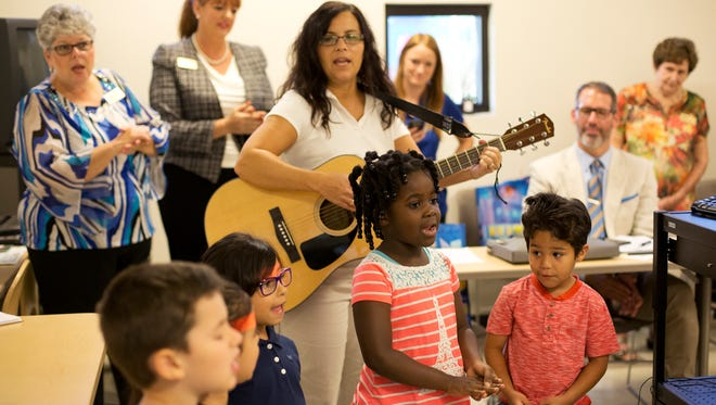 Students at the Naples Children & Education Foundation's Early Childhood Development Center at Florida SouthWestern State College sing for visitors Oct. 2, 2015. The center was the first stop on a Naples Alliance for Children bus tour of child care facilities to raise support for more funding for Collier early childhood learning programs.