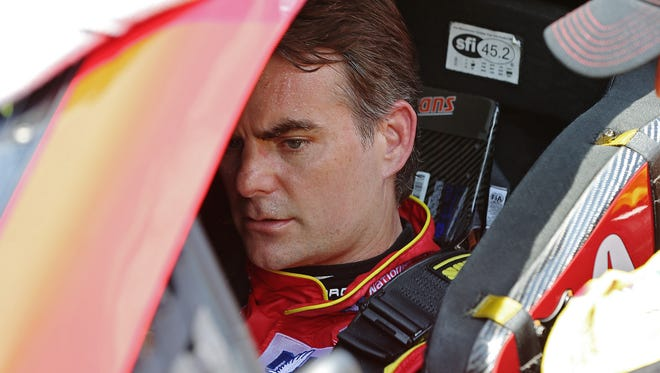 Jeff Gordon prepared to drive in Dale Earnhardt Jr.'s car just before the start of the 23rd annual Brickyard 400 on Sunday at Indianapolis Motor Speedway.