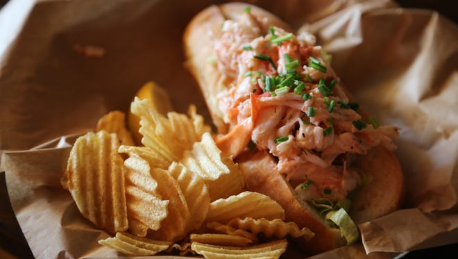 """The lobster is flown in fresh daily from Maine during """"Lobstah Roll Week"""" at Mudgie's Deli in Detroit's Corktown neighborhood, which kicked off Monday, July 25, 2016. The rolls are $19 and come with a side of Better Made crinkle-cut potato chips."""