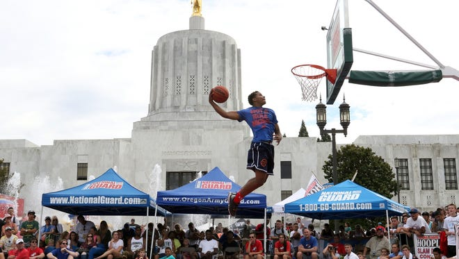 Charles Jones competes int the in the slam dunk contest during the Oregon National Guard Hoopla XVII at the Oregon State Capitol in Salem in 2015.