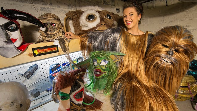 Indianapolis costume designer Jess West poses for a portrait in her basement workshop wearing a Chewbacca costume she has been creating for Gen Con, Friday, July 22, 2016.
