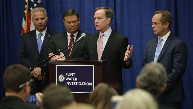 Attorney General Bill Schuette announces criminal charges against six state employees relating to the Flint water crisis on Friday, July 29, 2016, at the Harding Building on the University of Michigan-Flint campus in Flint.