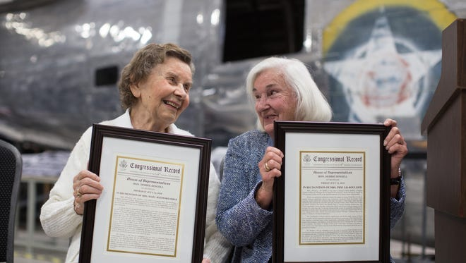 Mary Jezowski-Serge (left), 93, of Allen Park, and Phyllis Roullier, 97, of Belleville, laugh after receiving an award honoring the two original 'Rosie the Riveters' during a ceremony by Congresswoman Debbie Dingell honoring the women for their service during World War II at Yankee Air Museum in Belleville on Monday August 1, 2016.