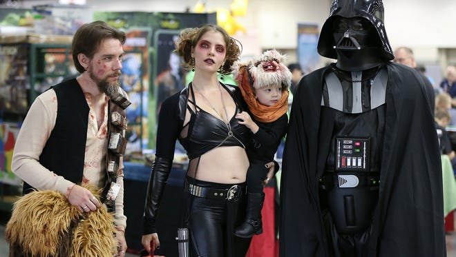 From left, Ryan Kinderman, wife Elizabeth Kinsman, Zed Kinderman, 2, and Jeff Bathke during Gen Con at the Indiana Convention Center, Indianapolis, Saturday, August 6, 2016.