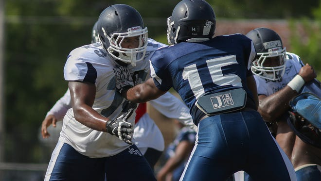 Jackson State tackle Christian Marshall (pictured in white) has taken a leadership role on the Tigers' offensive line.