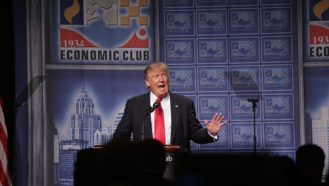 Republican nominee Donald Trump speaks to the Detroit Economic Club at Cobo Center in downtown Detroit on Monday.