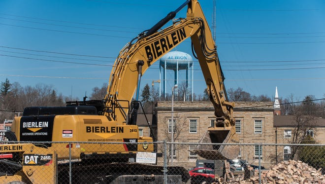 Demolition begins in downtown Albion to make way for a four-story boutique hotel, an $8.4 million project.