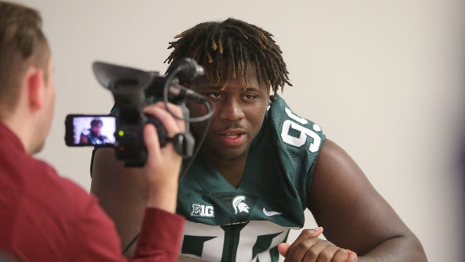 Michigan State defensive lineman Raequan Williams talks with reporters Monday, Aug. 8, 2016, at Spartan Stadium in East Lansing.