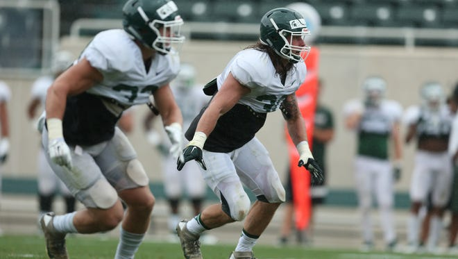 Riley Bullough, right, and the MSU defense won the Spartans' first jersey scrimmage Saturday, Aug. 13.