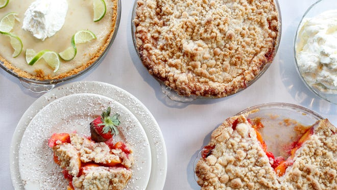 Clockwise from top left, Key lime pie, summer berry pie and Peach Melba pie with fresh whipped cream were made by Dominic Serratore, who is the chef and co-owner of Ditto's Grill on Bardstown Road in the Highlands. Aug. 3, 2016