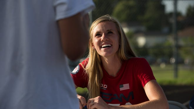 Courtney Frerichs is welcomed by fans in her home town of Nixa after returning from the Olympics. Frerichs signed autographs prior to the Nixa verses Willard match up Friday, August 19, 2016. Jason Connel / For the News-Leader