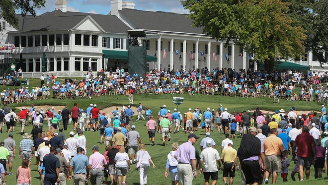 Fans watch action on the 18th hole during the final round of the U.S. Amateur Championship at Oakland Hills Country Club in Bloomfield Township MI. Sunday, August 21, 2016.
