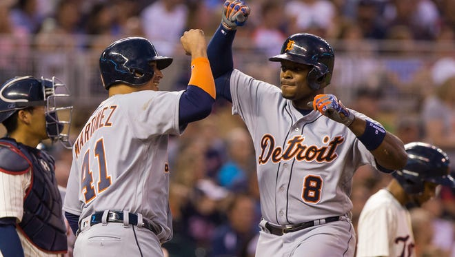 Tigers outfielder Justin Upton (8) celebrates with designated hitter Victor Martinez (41) after hitting a home run in the third inning of the Tigers' 9-4 win Wednesday in Minneapolis.