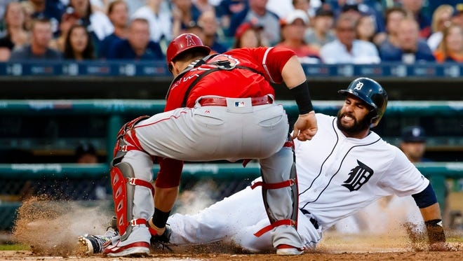 Tigers rightfielder J.D. Martinez (28) is tagged out by Angels catcher Jett Bandy (13) in the second inning Friday at Comerica Park.