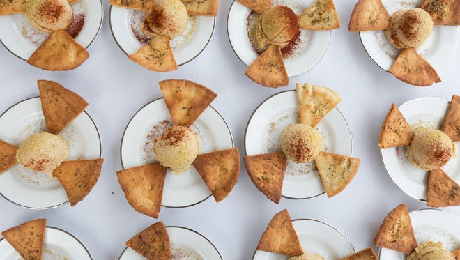 The second course, a smoked hummus dip and house made pita chips, waits for for service during Eat+Drink's Secret Supper at Mawson Lumber and Hardware Thursday, July 25, 2016.