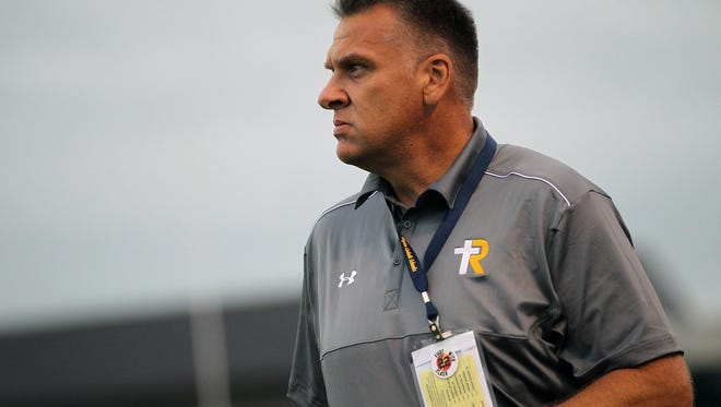 Regina head coach Marv Cook looks on as the Regals face Cedar Rapids Xavier in Cedar Rapids on Friday, Aug. 26, 2016.