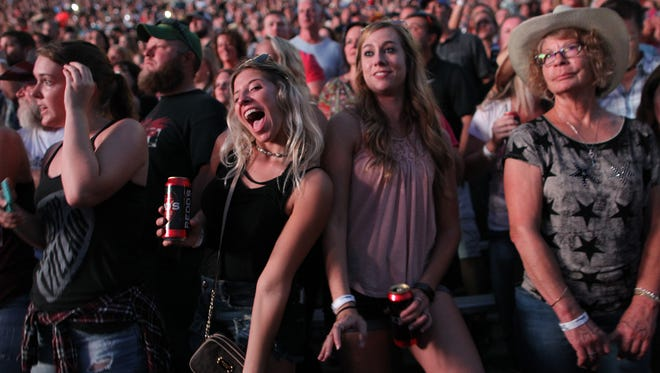 Fans enjoy Thomas Rhett's performance at the Back Porch Revival concert at Kinnick Stadium on Saturday, Aug. 27, 2016.