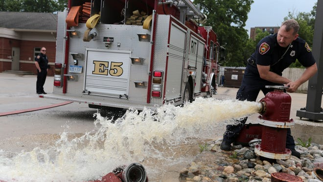 Captain Dave Wylie of the Wayne Fire Station 5, opens a fire hydrant behind the station as he prepares to hook up the hose to conduct a training exercise, on Thursday, June 23, 2016.  City of Wayne is asking voters if Wayne can join the South Macomb Oakland Regional Services Authority to raise money for Police and fire services. Wayne is facing a financial crisis and could be broke by the end of 2017.