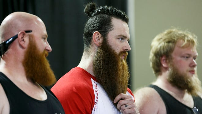 Jerry Braswell strokes his beard while competing at the Art of Not Shaving - Mustache or Beard Contest at the Oregon State Fair on Monday, Aug. 29, 2016.