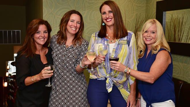 Mary Carol Perry, Kelly MacLeod, Autumn Clark and Cindy Mastow share a toast.
