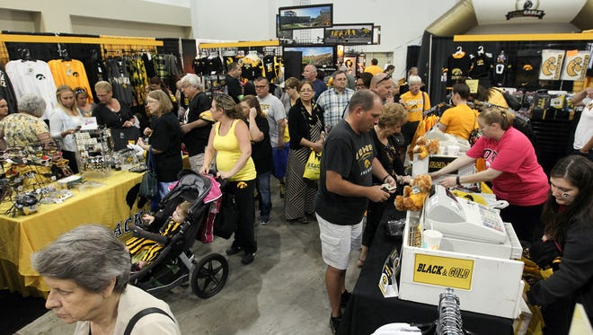 Hawkeye fans browse merchandise at Fry Fest at the Coralville Marriott on Friday, Sept. 2, 2016.