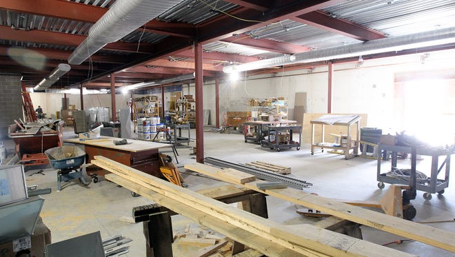Construction continues inside Clear Creek Amana's new weight room on Tuesday, Sept. 6, 2016. The renovation provides a full area for weights, with the wrestling room now located on the second floor.