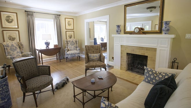 A formal living room features a re-surfaced fireplace in Jedd Pearl and husband Danny Devers' 1922 Prairie Style home in historic Irvington. The home is on tour Sept. 18.